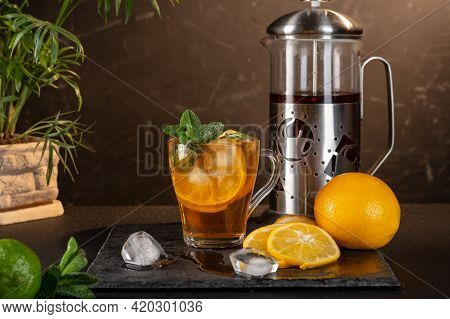 Iced Tea With Lemon And Mint. Cool Iced Tea. Thirst Quenching Tea. Front View.