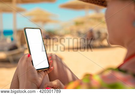 Mockup Image. Woman's Hand Holding Black Mobile Cell Phone With Blank Desktop Screen While Laying Do