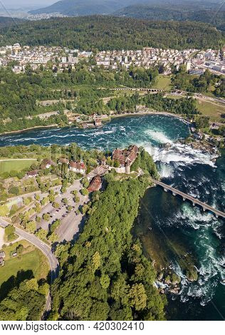Dachsen, Switzerland - May 17.2020: Aerial Photography With Drone Of Rhine Falls With Schloss Laufen