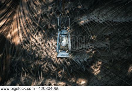 Hurricane Lantern Hangs Outside The Village Cabana House,