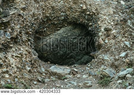 Beautiful Nature Background With Big Black Stone In Hole In Mountain. Minimalist Mountain Landscape