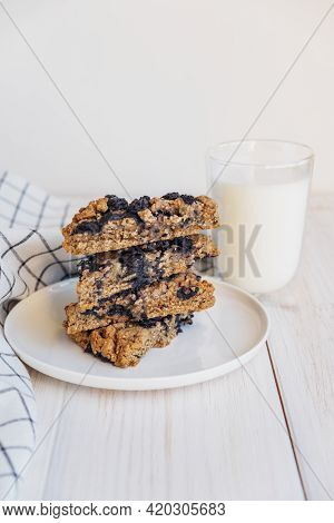Stack Of Homemade Oatmeal Scones With Berries Stacked On White Plate And Glass Of Plant Based Milk.