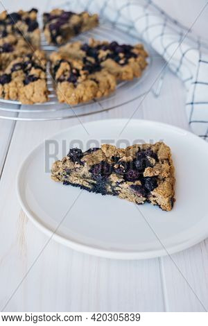 Freshly Baked Oat Blueberry Scones On White Wooden Background. Sweet Food With Natural Ingredients.