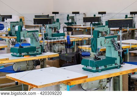 There Are Many Industrial Sewing Machines In The Workshop. They Can Sew Plastic Fabric, I.e. Hdpe .