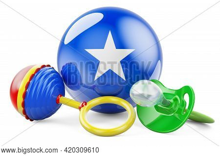 Birth Rate And Parenting In Somalia Concept. Baby Pacifier And Baby Rattle With Somali Flag, 3d Rend