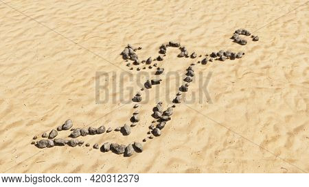 Concept conceptual stones on beach sand handmade symbol shape, golden sandy background, volleyball player sign. 3d illustration metaphor for sport, competition training,  relaxation, family and fun