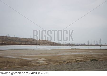 They Laid The Railway Lines On Top Of Each Other. A Small Lake And Oil Rocks In The Desert. The Wate
