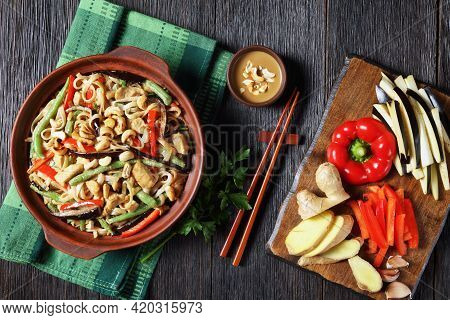Chicken Satay Rice Noodle With Green Beans, Pepper And Eggplant In A Bowl On A Wooden Table With Ing