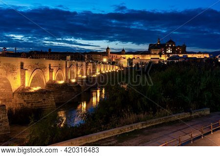 Cordoba, Spain - October 30, 2019: Mezquita-catedral And Puente Romano - Mosque-cathedral And The Ro