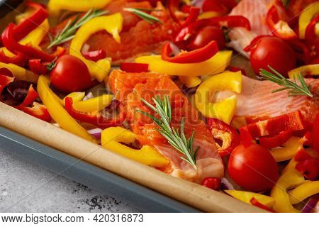 Baking Sheet With Arctic Char And Vegetables
