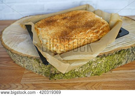 Freshly Baked Coconut Buttermilk Cake On A Tree Slice