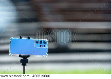 Riga, Latvia - May 01, 2021: Modern Smartphone With Several Cameras On A Telescopic Tripod, Selfie U