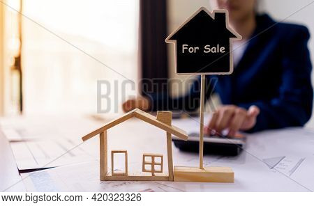 The Concept For Sell, Rent, Loan, Insurance Home. Realtor Real Estate Or Housing Agents Using The Ca