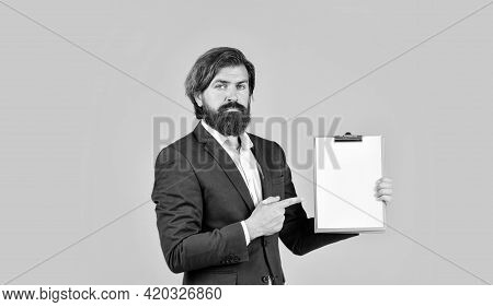 Look Here. Erp Consultant Making Notes. Company Executive Working With Documents. Mature Man In Jack