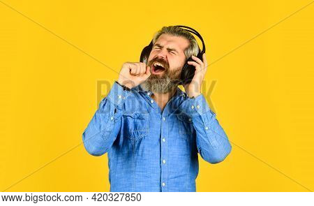 Singer On Rehearsal. Hipster Enjoy Excellent Sound Song In Earphones. Music Beat. Noise Cancelling F