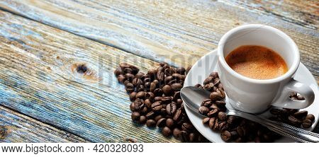 Top View. Beans And Cup Of Hot Italian Espresso Coffee On A Light Blue Rustic Wooden Background. Foo