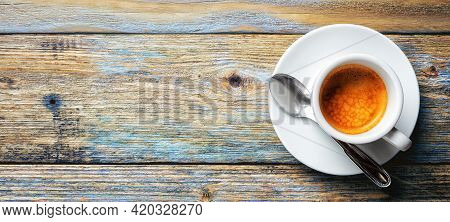 View From Above. Cup Of Hot Italian Espresso Coffee On A Light Blue Rustic Wooden Background. Food A
