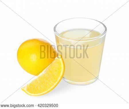 Freshly Squeezed Juice And Lemons On White Background