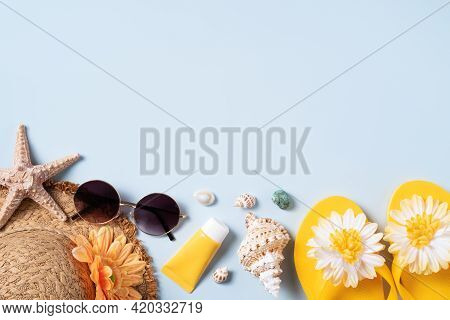 Summer Beach Background Design Concept With Shells, Hat, Slipper On Yellow Background.