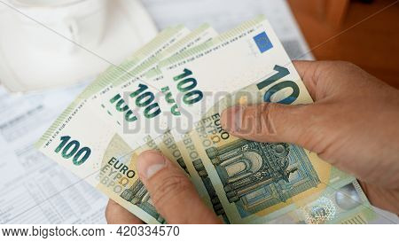Family Budgeting. Man Counting Euro Bills Close-up
