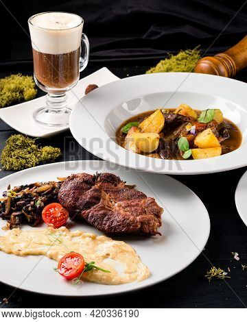 Irish Dinner. Beef Meat Stewed With Potatoes, Carrots And Soda Bread On Wooden Background, Top View,