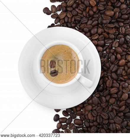 Cup With Aromatic Coffee And Pile Of Beans On White Background, Top View