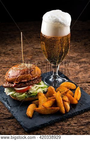 Set Of Hamburger Beer And French Fries. A Standard Set Of Drinks And Food In The Pub, Beer And Snack