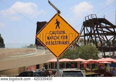 Caution watch for Pedestrians Traffic Sign.