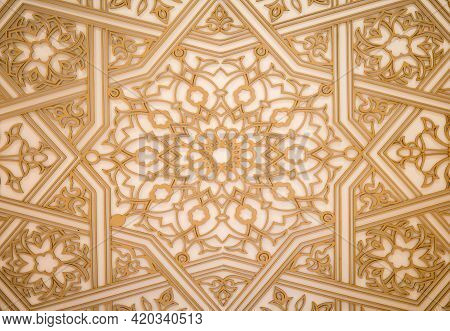 A Beautiful Rich Pattern On The Wall Is Carved From Wood In An Oriental Style. Wooden Background For