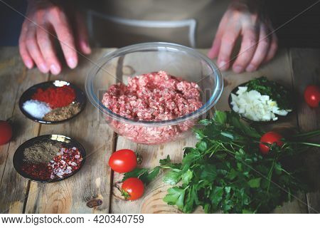 Minced Meat In A Bowl And The Hands Of The Cook. Cooking Minced Meat For Burgers Or Grilling.