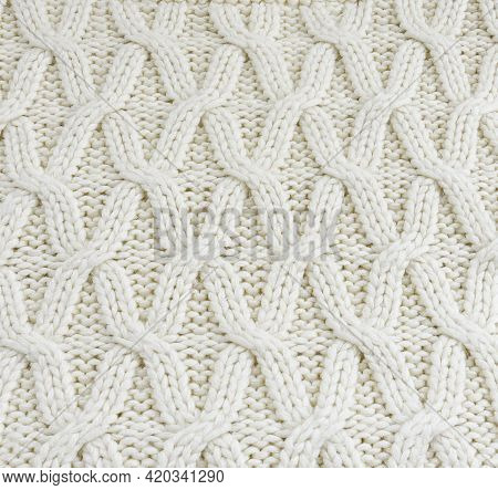 Knitted Jersey Background With Embossed Pattern. Braids In Knitting.