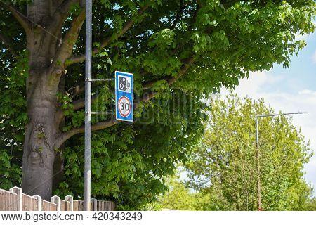 30 Mph Speed Limit Warning Of Traffic Camera On City Street