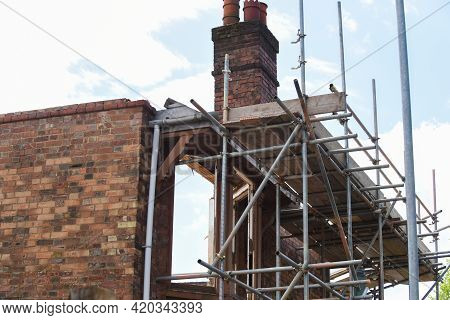 Scaffolding On Building Exterior To Allow For Renovation Works