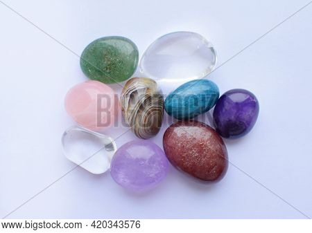 Tumbled Gems Of Various Colors. Amethyst, Rose Quartz, Agate, Apatite, Aventurine, Rock Crystal On W