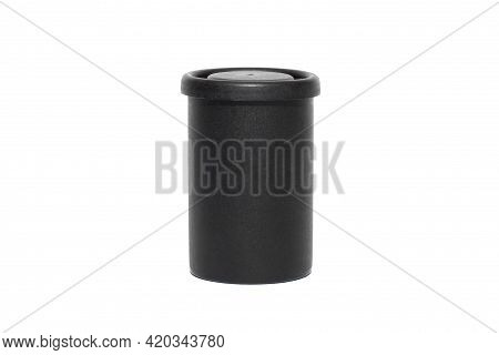Black Plastic Film Roll Case On A White Isolated Background