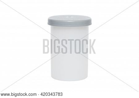 Gray Plastic Film Roll Case On A A White Isolated Background