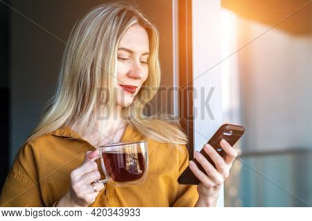 Businesswoman with smartphone, talking video call. Online chat with family, work colleagues, friends. Long distance communication. Staying connected, Social distancing, stay at home, face time.