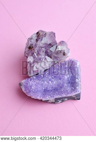 Beautiful Big Crystals Of Amethyst On A Pink Background.amethyst Purple Druzes Of High Quality.