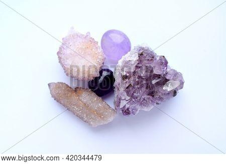 Amethyst Purple Natural Stones In Different Varieties. Tumbled Stones, Amethyst Druse And Cactus Qua