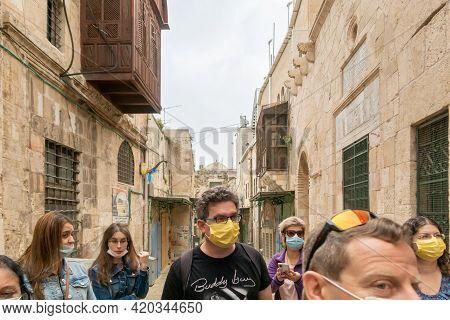 Jerusalem, Israel, March 23, 2021 : Tourists Wearing Protective Masks Due To Coronavirus Travel Thro
