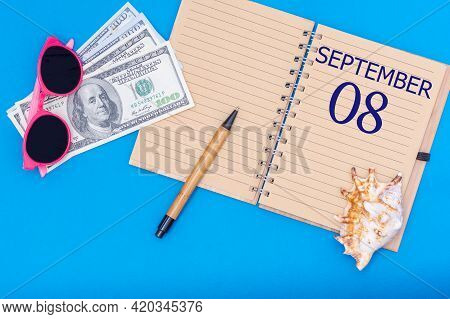 8th Day Of September. Travel Concept Flat Lay - Notepad With The Date Of 8 September Pen, Glasses, D