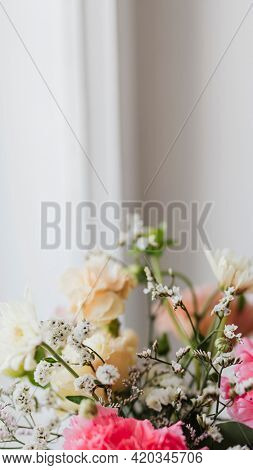 Closeup of carnations in a vase by the window
