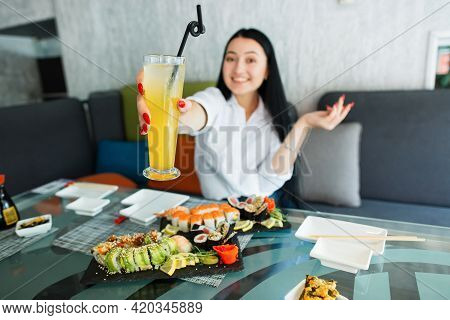 Time For A Lunch And Summer Drink. Fresh Tasty Japanese Food. Pretty Excited Asian Young Woman In Wh