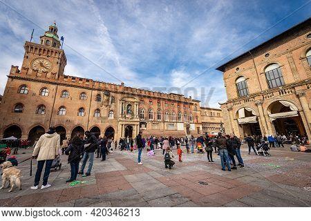 Bologna, Italy, - Feb 23, 2020: Piazza Maggiore, The Main Square, With Podesta Palace And Accursio P