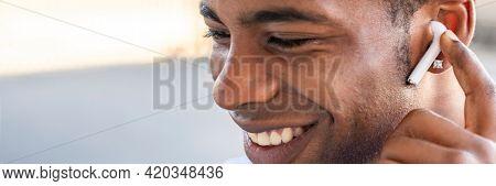 Man listening to music by wireless earphones