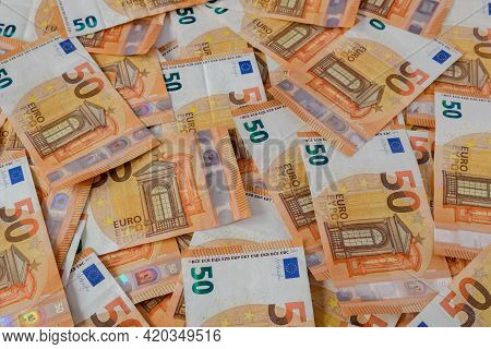 Close-up Of 50 Euro Bills Spread Out In A Mess