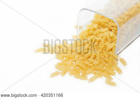 Fusilli Macaroni Placer . Macaroni Spills Out Of The Jar. Article About Pasta. Isolated Background.