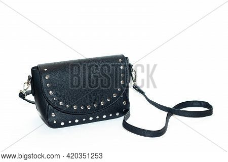 Women's Black Bag Isolated On A White Background . Leatherette Bag. Article About Fashion And Trends
