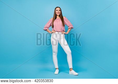 Full Length Body Size View Of Gorgeous Cheerful Straight-haired Girl Posing Isolated Over Bright Blu