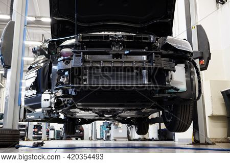 Moscow Russia - May 11 2021:car In A Car Service On A Lift. The Machine Is Partially Disassembled An